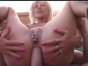 Pierced blond seductive mom with muff piercings