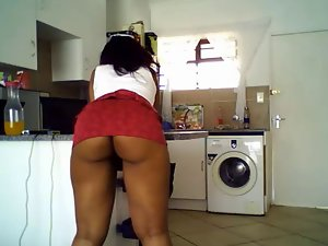 Ebony lass with succulent butt teasing in kitchen