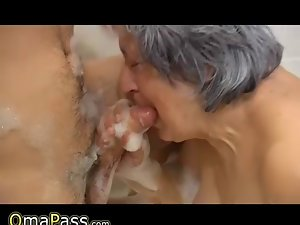 So experienced plump Granny playing with couple in bath