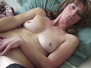 Attractive mature mama with very hairy aged pussy