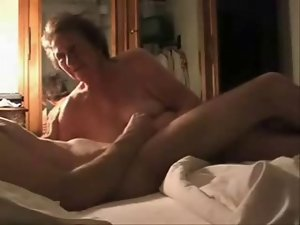 Caught my slutty mom having fun with her younger lover. Hidden cam