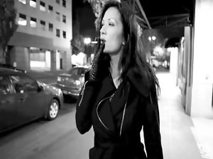 Great dark haired smoking with leather gloves