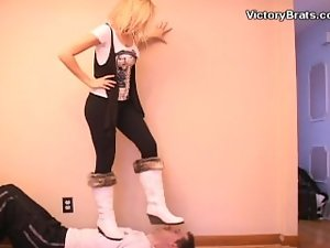 Gorgeous tempting blonde in white boots face trample