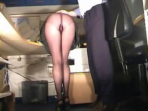 Secretary in pantyhose spanked