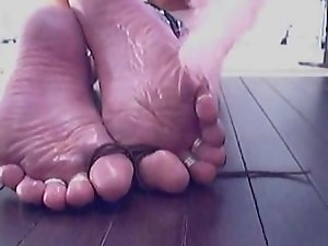 Oiled Soles Tickled