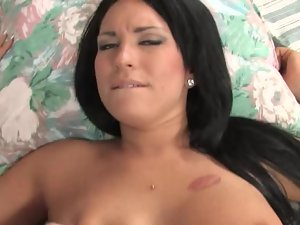 A top heavy bimbo is getting her twat lips expanded on the bed