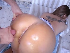A chesty dark haired with a large butt is getting cumshot on her bum