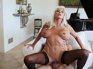 Blond granny in sexual stockings needs a big meat pole right now