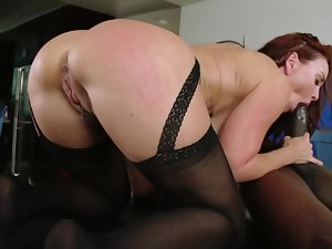 A redhead that has a sexual butt is getting her cunt lips fondled