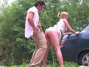 A blondie receives a double facial in a crazy threesome action out in public