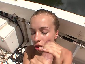 Graceful angel with beauteous face gives dick sucking on a boat