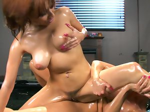 Two ladies are screwing each other in some oil in this lewd episode
