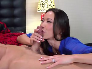 A dark haired Asian lady is fooling around in her bedroom with a man
