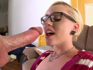 A blond with glasses and a firm butt is getting her narrow pussy kissed