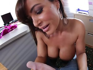 A filthy bitch with mega boobs is getting tit banged in her office