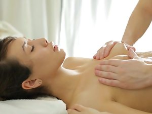 A sensual girlie is on the massage table getting her butt kissed