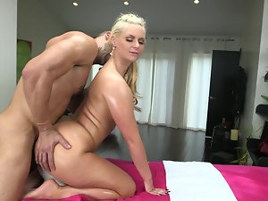 Great attractive light-haired Phoenix Marie gets oiled up and hammered so brutal