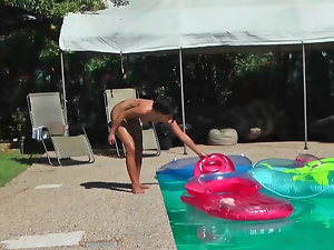 Lassie Maze is lounging nude in the pool in this video