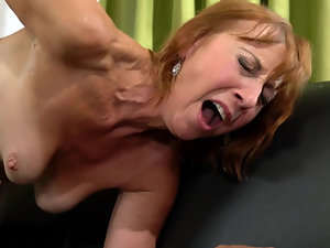 Mature ginger welcomes young pecker in her shaved cunt