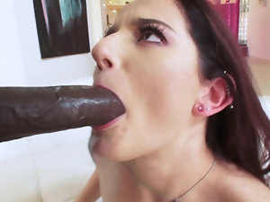 A sexy all natural pornstar teases a big black cock with her face